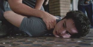 Pictured: Stiles being restrained for something another patient did.